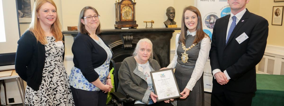 Jenny Robinson, Sinead Dynan and Scott Kennerley (The Consumer Council) and Vivien Blakely (IMTAC) are presented with 2017 WHO Belfast Health City Awards commendation by Lord Mayor Nuala McAllister.