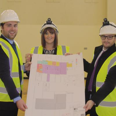 Image 1 – Noel Rooney, Ortus Property Development Executive, Catherine McClelland, Roar and Explore Project Manager and Conor Smith, Housing Executive System Manager Social Investment Team with the plans for Roar and Explore