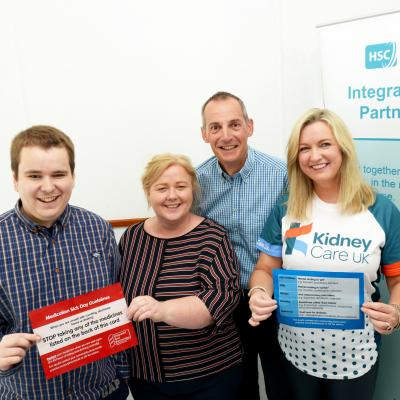 Organ donation champion Jo-Anne Dobson and her son, Mark, who underwent a recent kidney transplant, promote a new 'sick day' card to help people keep their kidneys healthy. Included with them are Dr John Harty, from Southern Trust's renal unit and Michele Bekmez, Southern area Integrated Care Partnership.