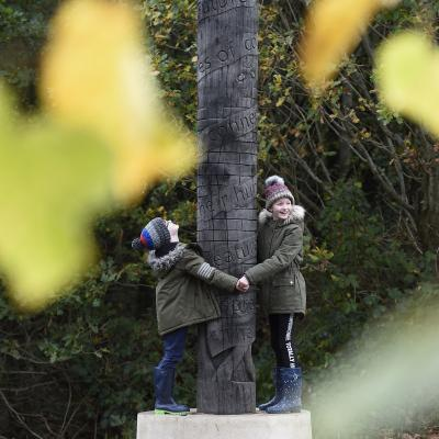 Jack and Sophie Tinman inspect the new charter pole at Friends of Belvoir Wood