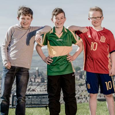 Boys photographed posing for the camera at Marrowbone Playing Fields, Oldpark Road, Belfast, Northern Ireland for a feature in Bout Yeh magazine