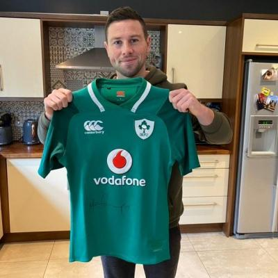 Rugby's John Cooney donated an Ireland jersey to raise much-needed cash for Cancer Focus NI.